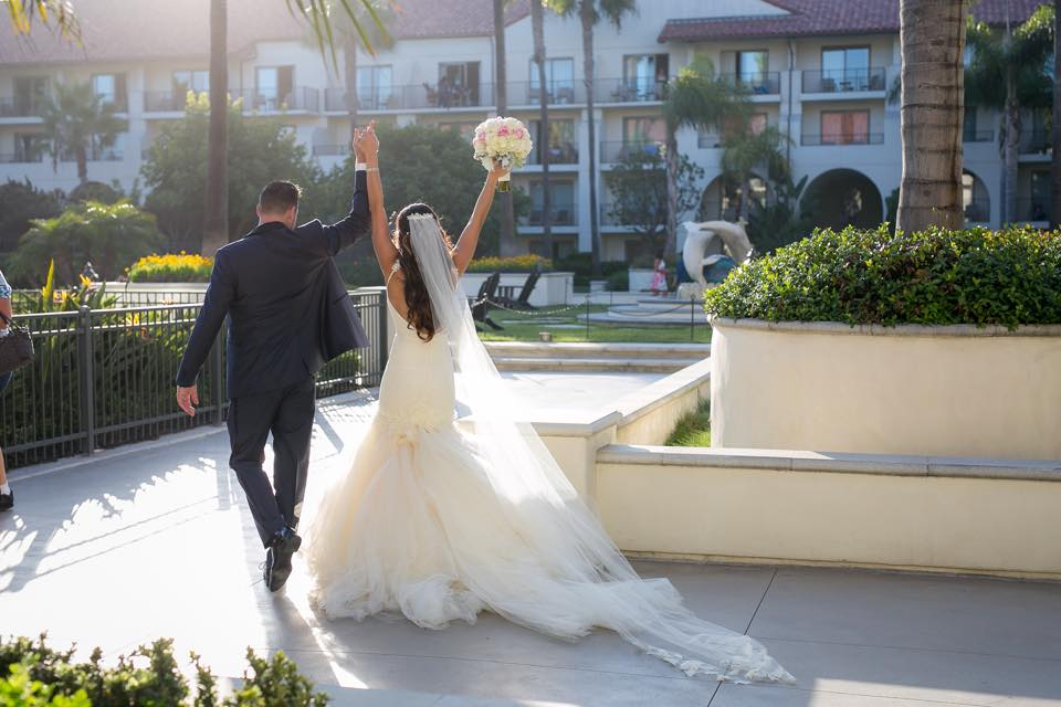 Bride Sunshine celebrates at the Hyatt Regency Huntington Beach in her custom Lauren Elaine Bridal mermaid wedding gown and veil