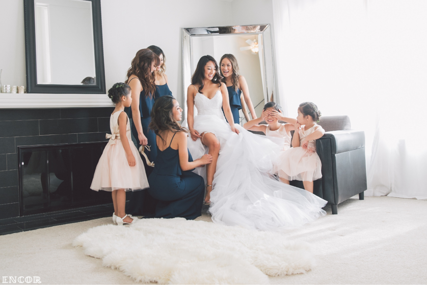 Michele sits with bridal party in her Lauren Elaine Jasmine Bridal Gown