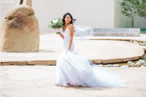 A bride runs on the beach in her Lauren Elaine mermaid wedding gown