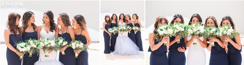 Michele poses with her bridesmaids in her custom Lauren Elaine wedding dress