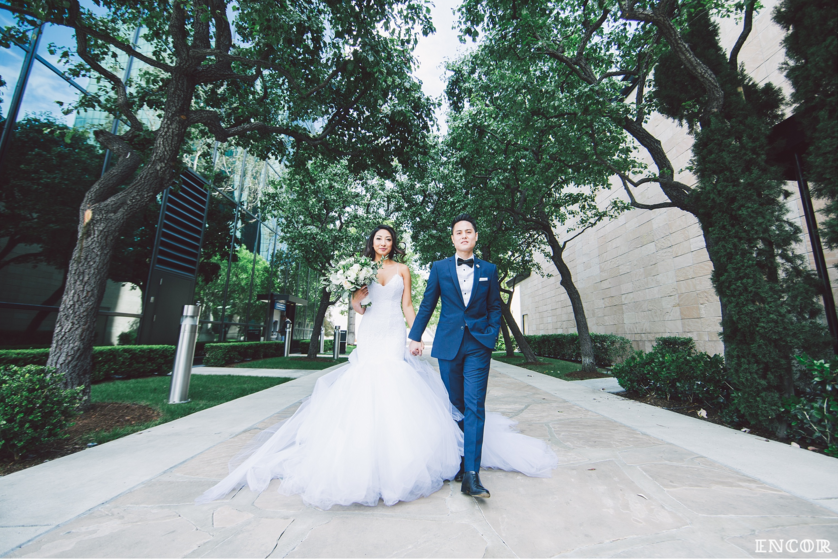 Michele strolls in her glamorous mermaid wedding gown and dress by Lauren Elaine