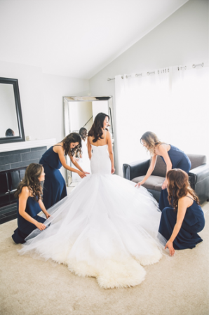 Back view of a backless mermaid wedding gown by Lauren Elaine Bridal