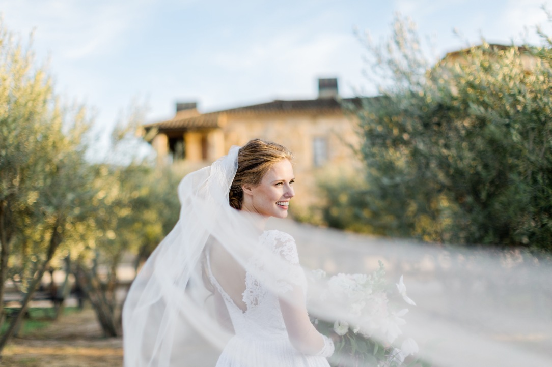 Alyssa Campanella's fairytale Santa Ynez Sunstone california wedding in her custom Lauren Elaine gown and veil.