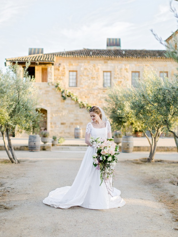 Alyssa Campanella's custom Lauren Elaine wedding gown with lace illusion sleeves and cathedral train