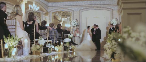 Chelsea wears a custom Lauren Elaine Aurelia bridal gown with detachable cathedral tulle traine