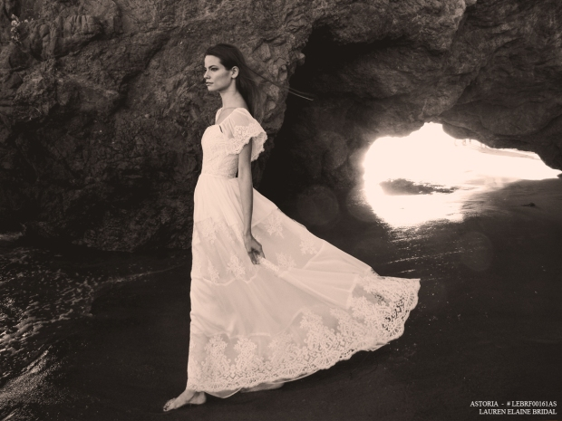 "Vintage-inspired lace and chiffon a-line ""Astoria"" wedding gown by Lauren Elaine Bridal, with scalloped lace hemline and ruffled flutter sleeves."