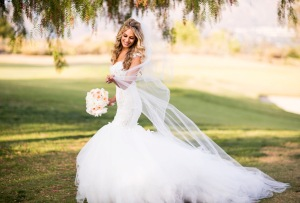 Bride Tal wears her custom Lauren Elaine mermaid wedding gown with detachable cathedral tulle train and veil with blusher.