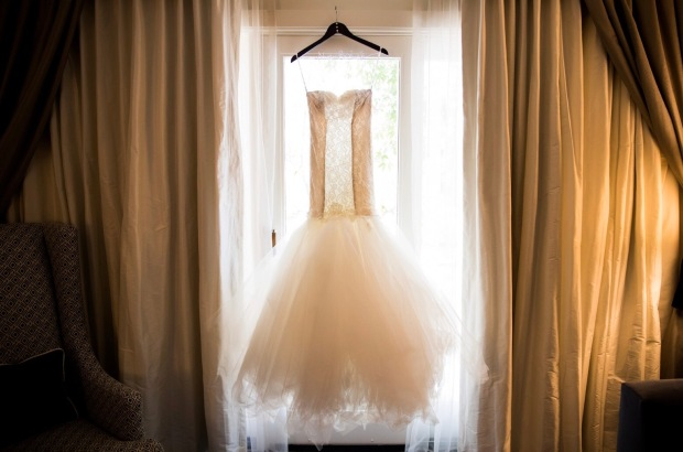 Custom Lauren Elaine Bridal mermaid wedding dress with champagne illusion side paneling and feathered tulle skirt with detachable cathedral train.