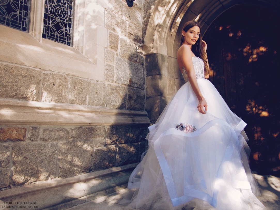 Something blue colored wedding dress with tulle ball gown skirt and horsehair petals with flower details