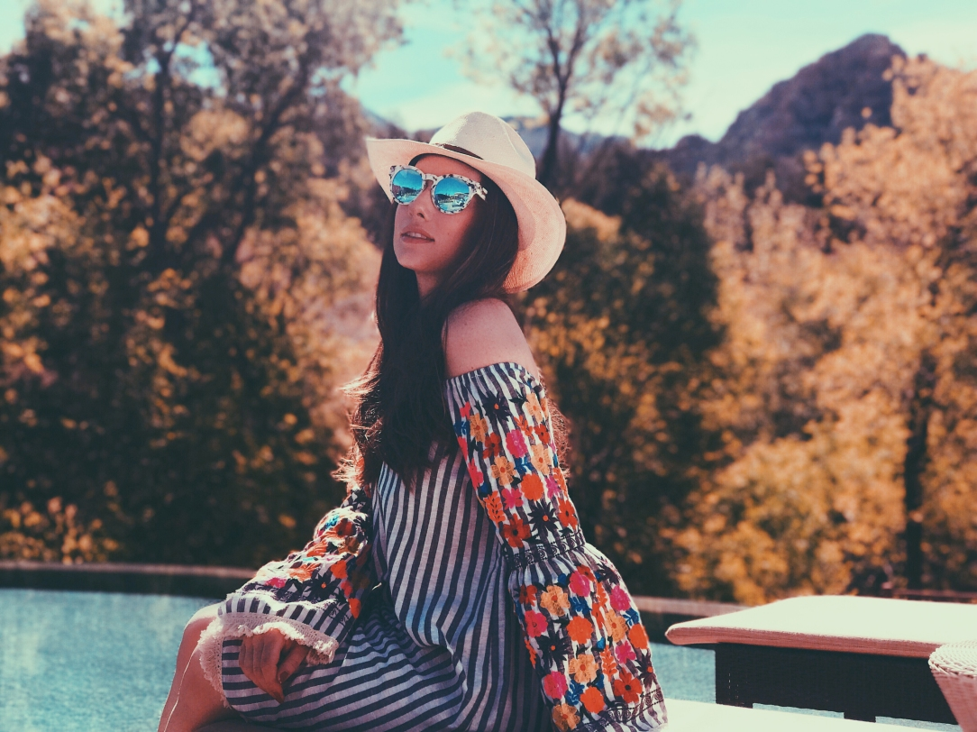 Designer Lauren Elaine soaks up the sun poolside at Hotel Amara in Sedona, Arizona