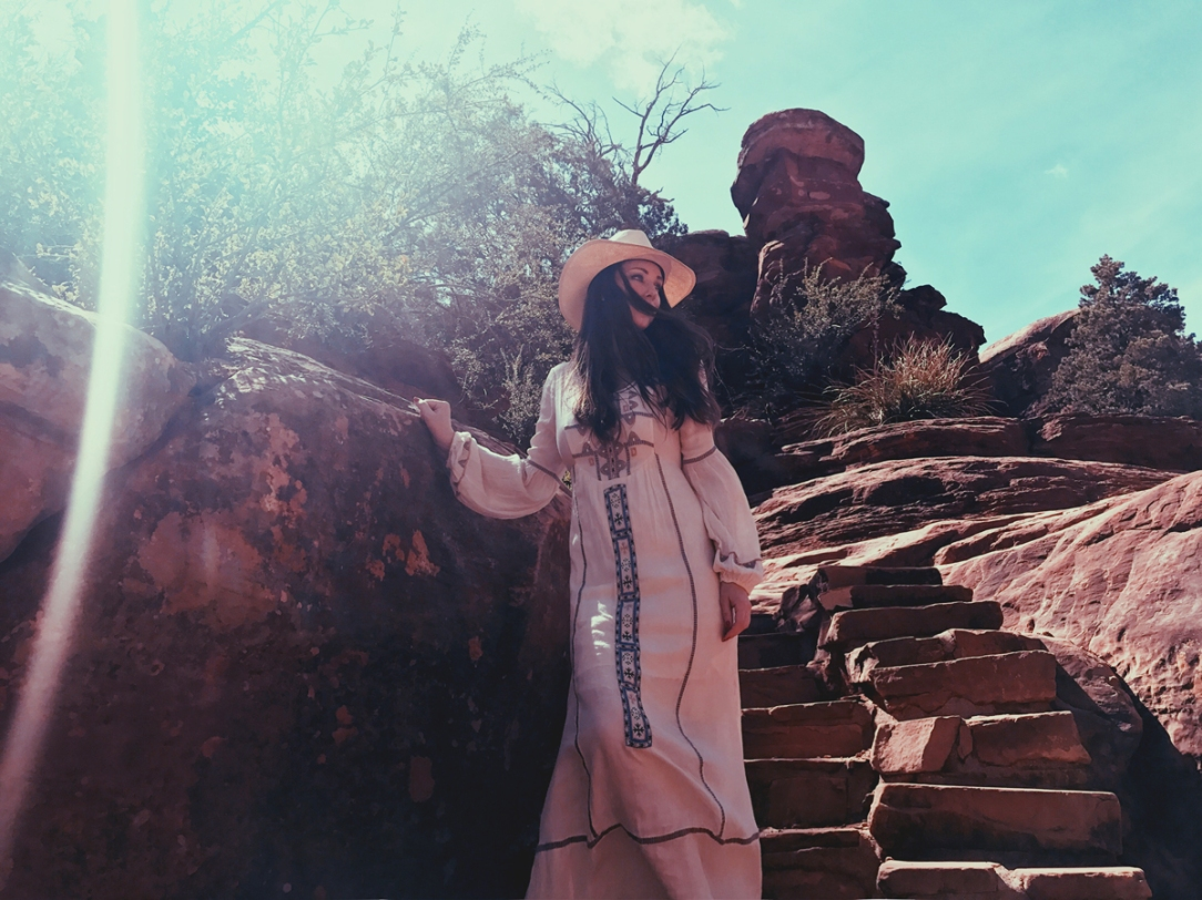 Designer Lauren Elaine explores Slide Rock in Sedona, AZ in Free People Desert Winds dress