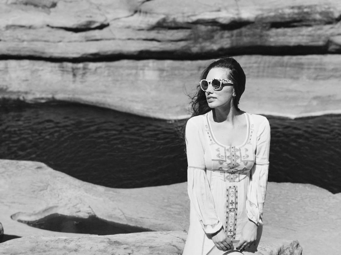 Designer Lauren Elaine explores Slide Rock State Park in Sedona, Arizona wearing bohemian Free People Desert Wind's maxi dress with Quay Australia Sunglasses