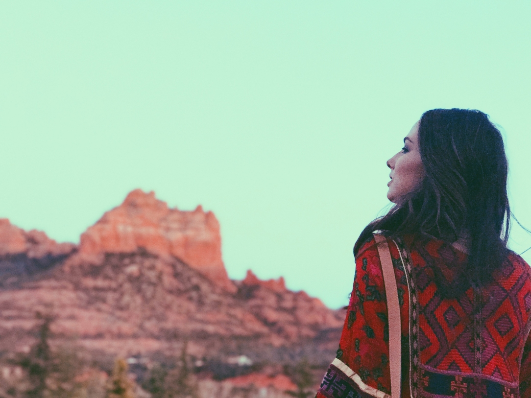 Designer Lauren Elaine watches a red rock Sedona, AZ sunset at L'Auberge Resort and Spa