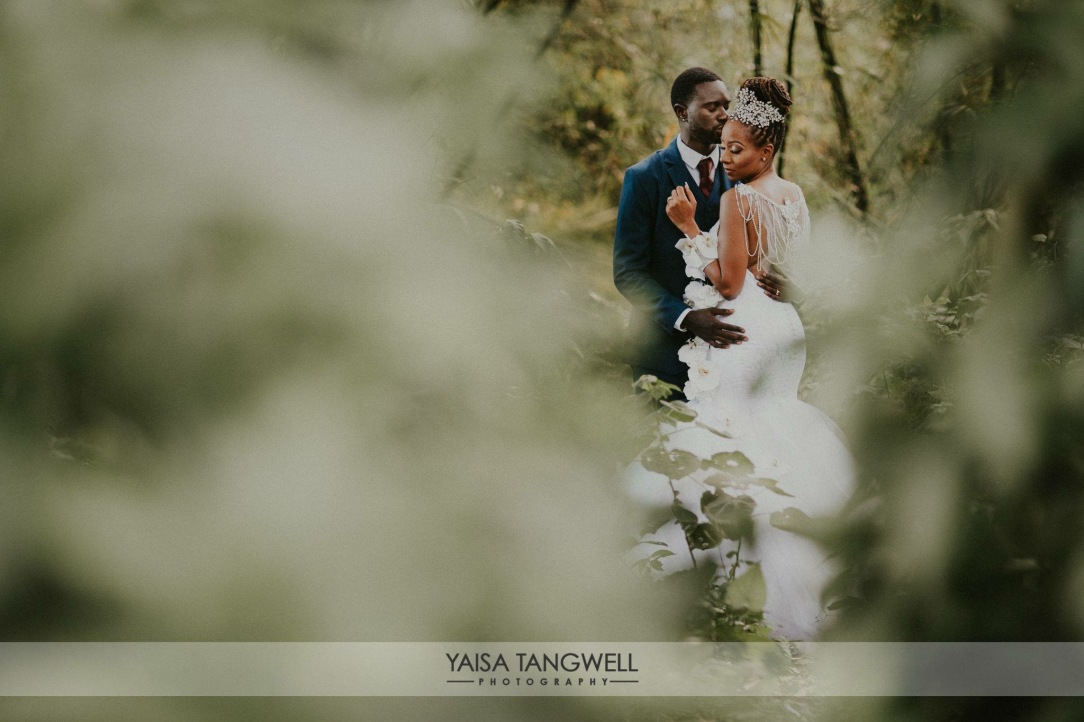 Bride and groom embrace in an enchanted fairytale forest for their Caribbean wedding by yaisa tangwell photography