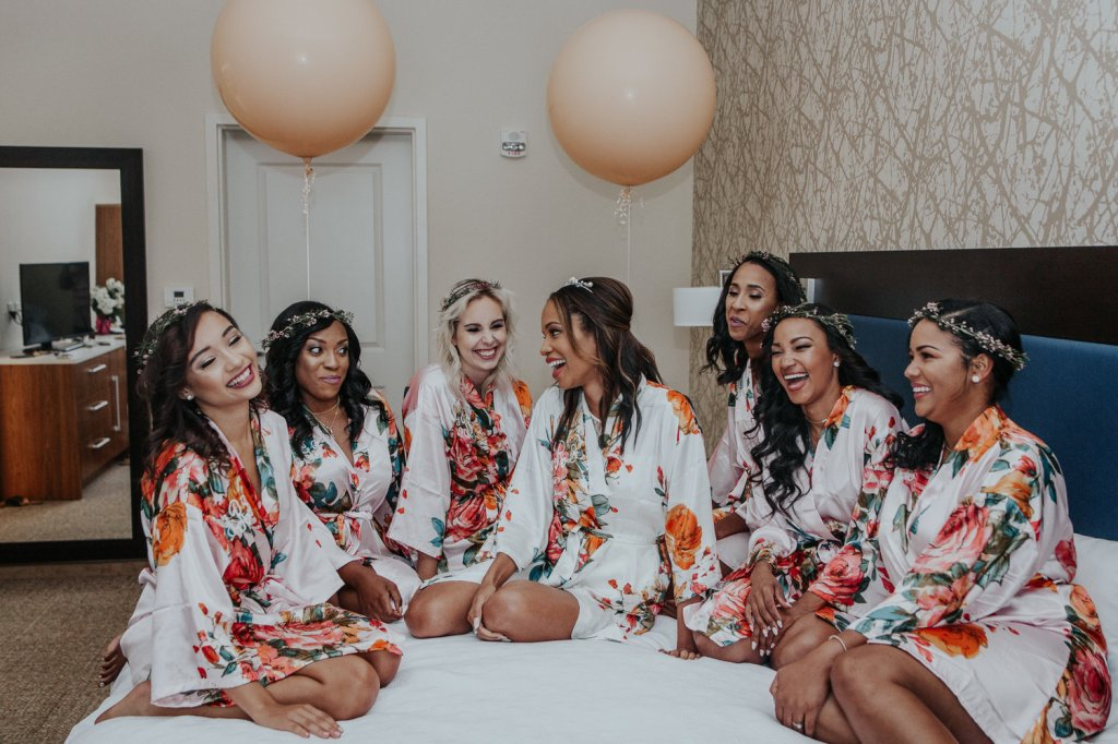 Bride Harmony and her bridal party in floral robes