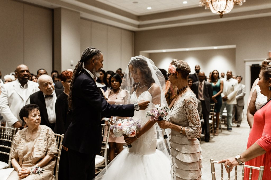 Bride Harmony walks down the aisle in her Lauren Elaine Arabelle wedding dress in Lafayette, Louisiana