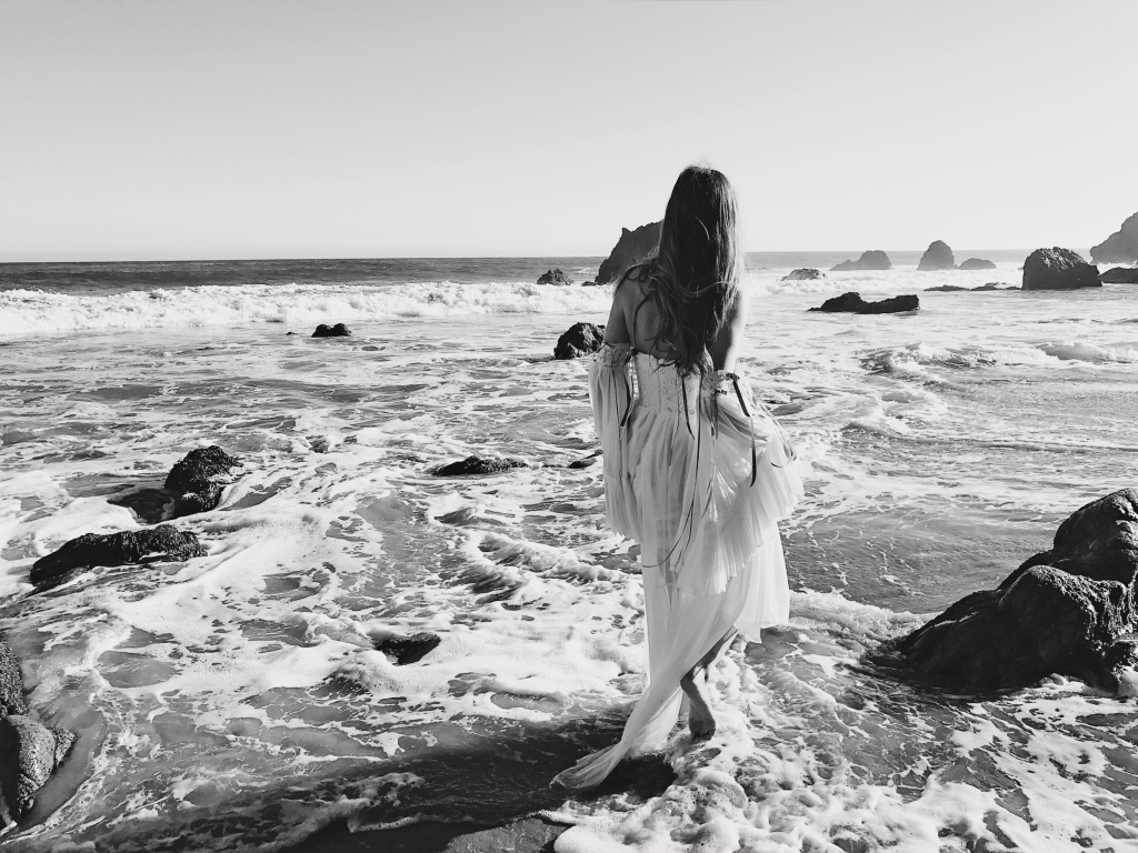 Fairytale fashion editorial featuring bridal gowns on the beach in malibu california