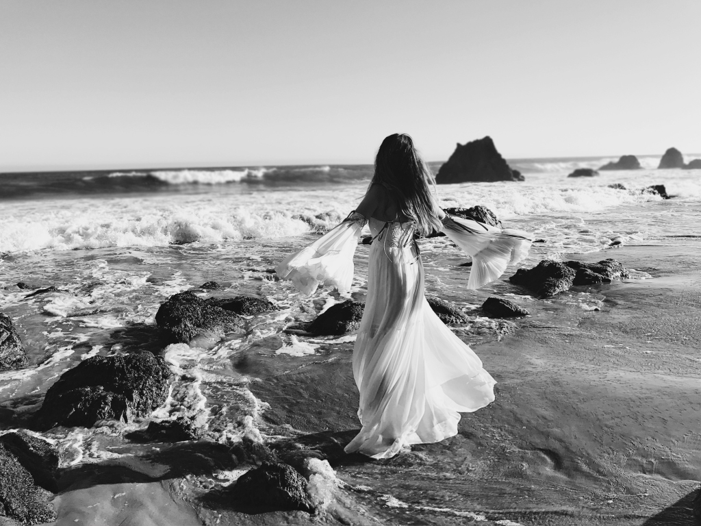 Ethereal fairytale fashion editorial featuring los angeles designer Lauren Elaine at el matador beach in malibu