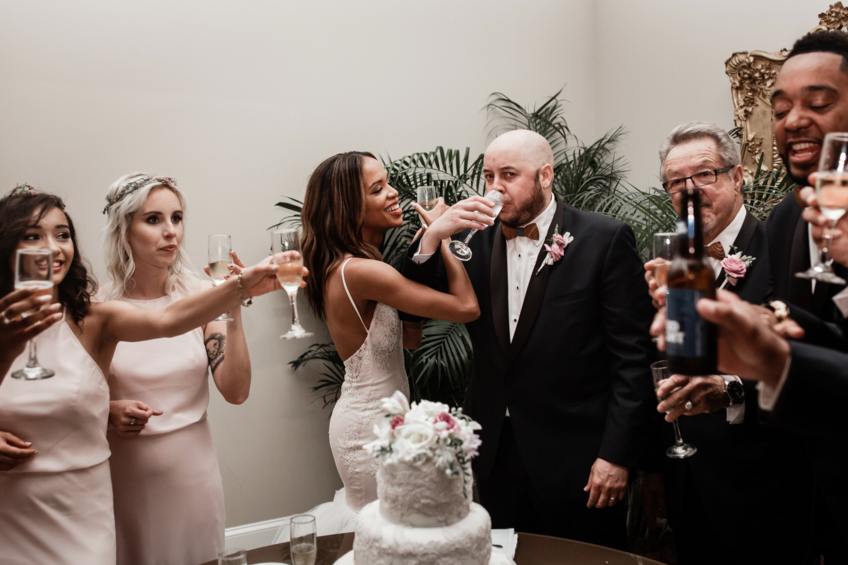 Bride Harmony drinks champagne in her Lauren Elaine Arabelle wedding dress