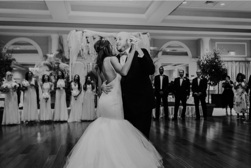 Bride Harmony shares a first dance in her Lauren Elaine Arabelle wedding gown at La Pavaillion