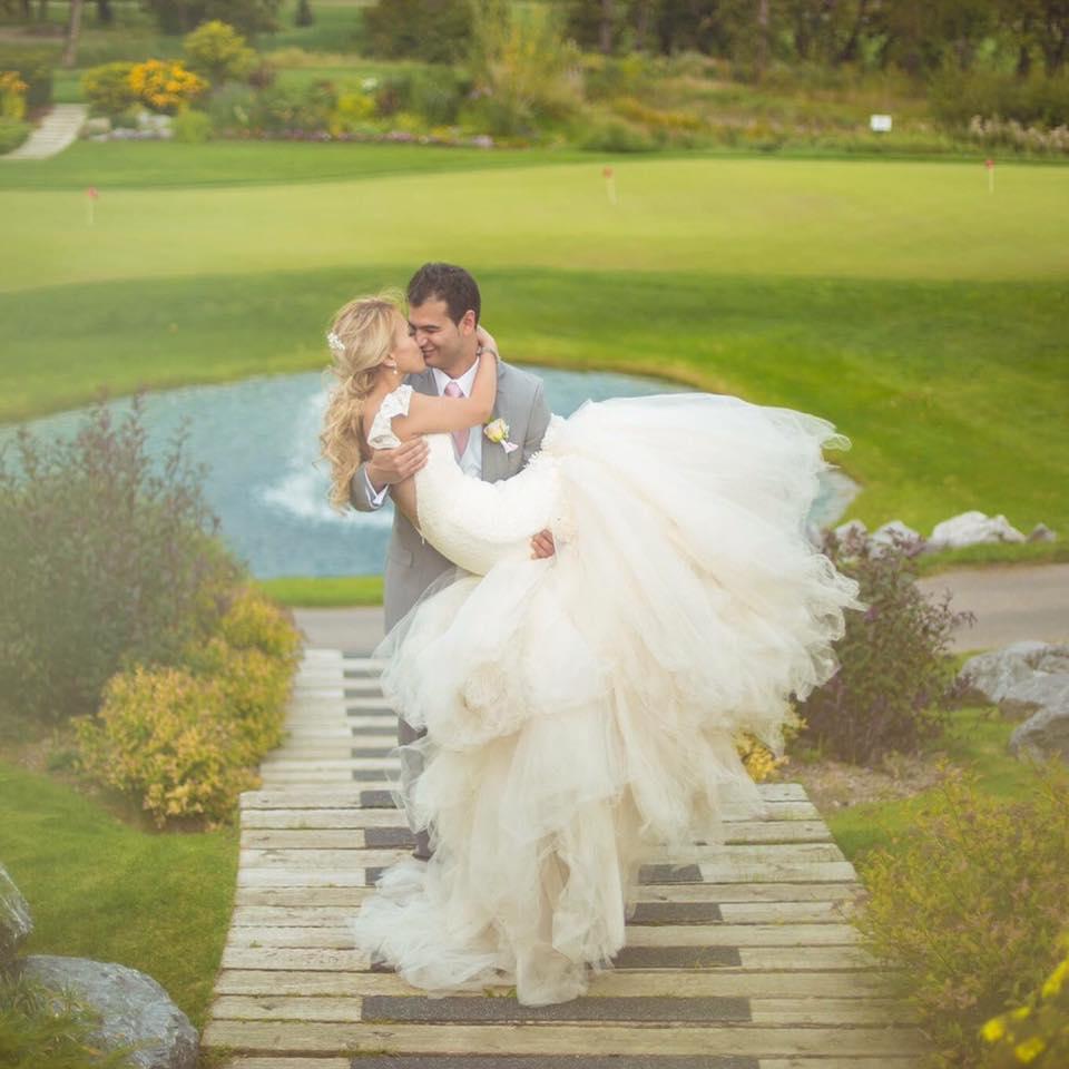 Bride Aprille wears a custom Lauren Elaine Aurelia gown