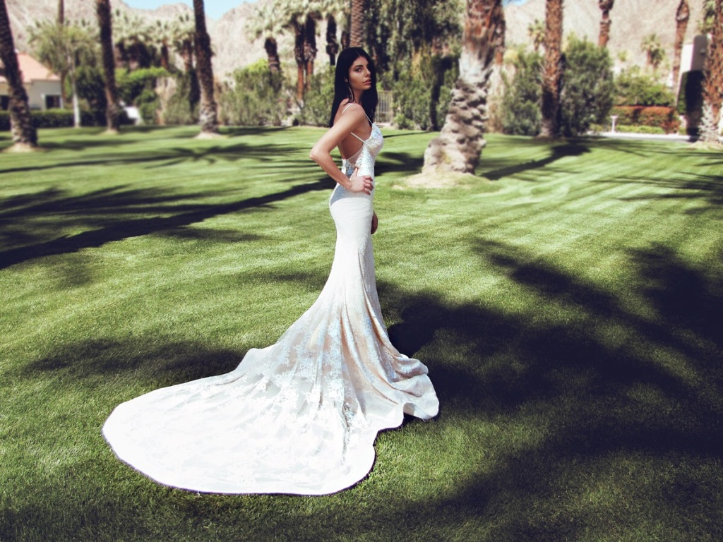 Backless mermaid form-fit wedding dress with crystal and pearl detailing for destination beach wedding by Lauren Elaine Bridal