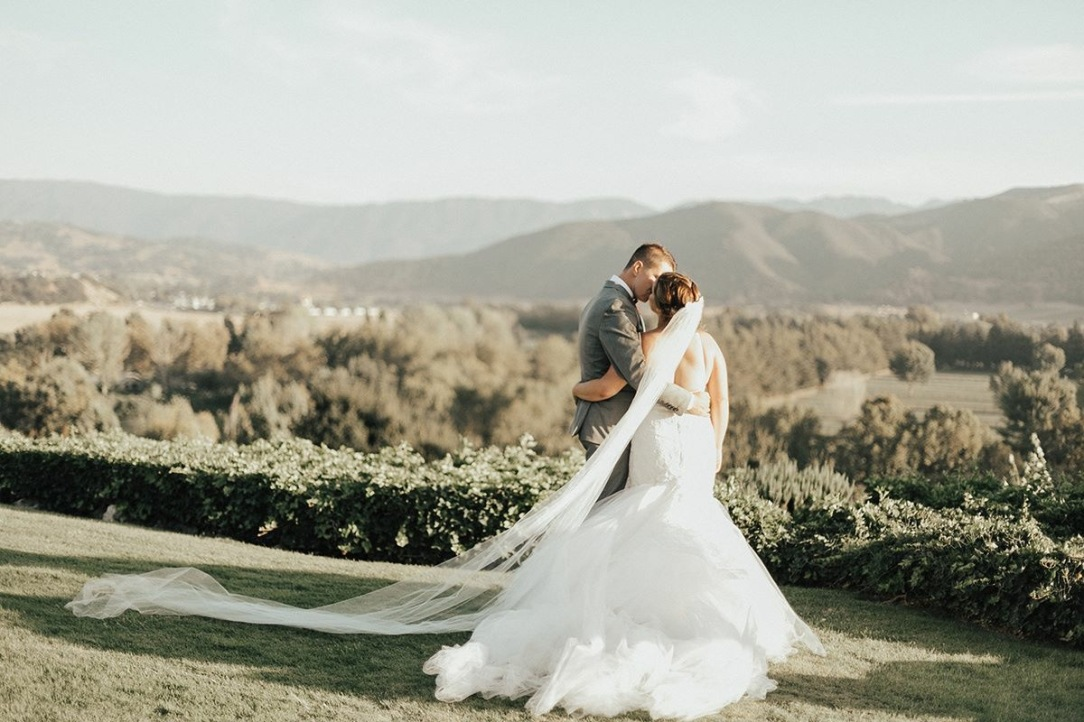 "Bride Allyson wears a custom Lauren Elaine ""Calais"" bridal gown at Whispering Rose Ranch in Santa Ynez, CA."