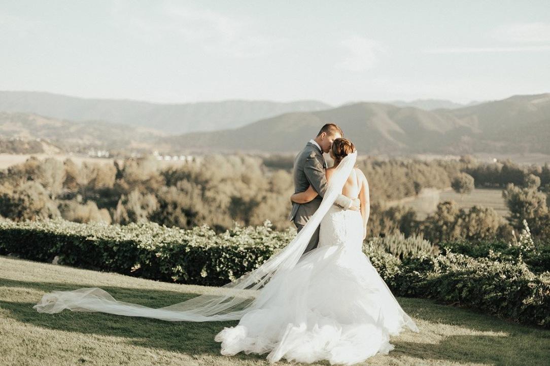 "Bride Allyson wears a custom Lauren Elaine ""Calais"" bridal gown at Whispering Rose Ranch in Santa Ynez, CA."