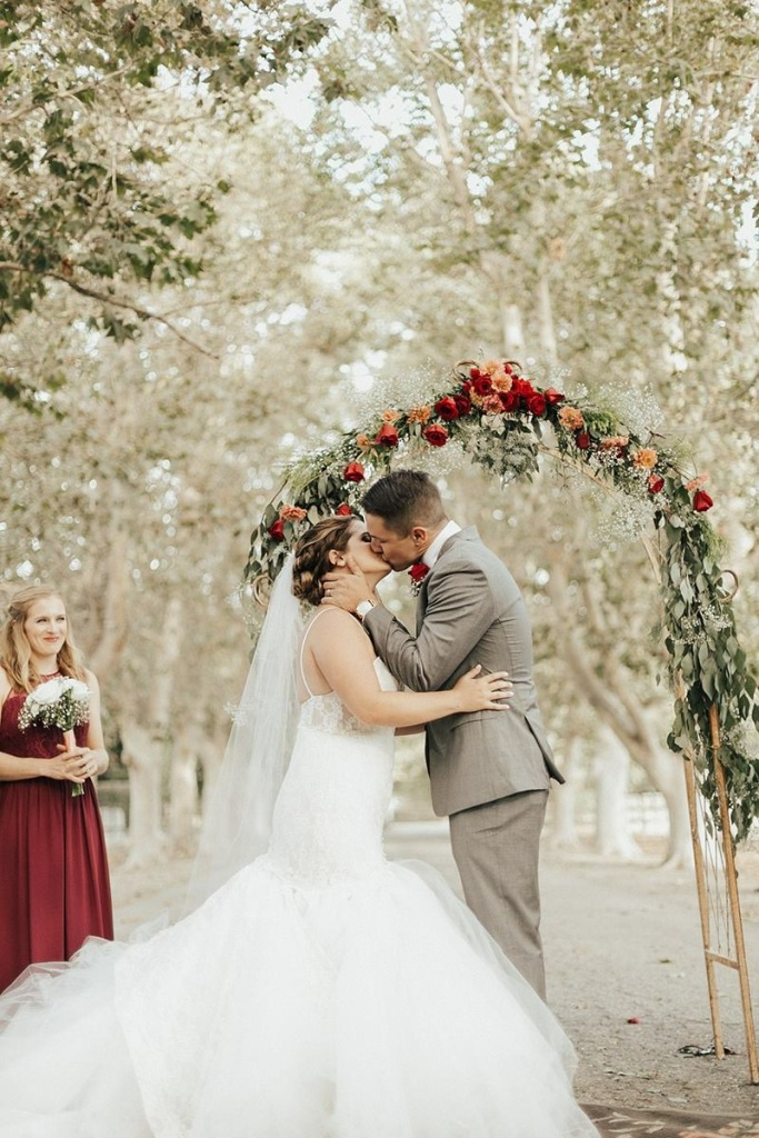 Bride Allyson ties the knot at Whispering Rose Ranch in Solvang, CA in a Lauren Elaine wedding dress.