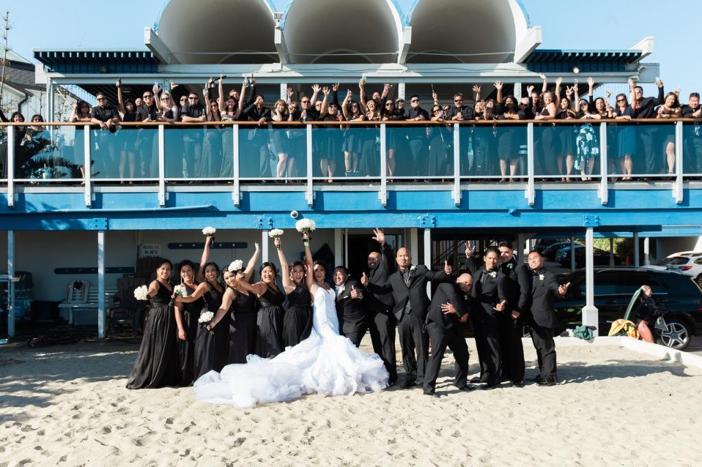 "Bride Kimberly celebrates in her custom Lauren Elaine ""Arabelle"" mermaid wedding dress with 8ft train."