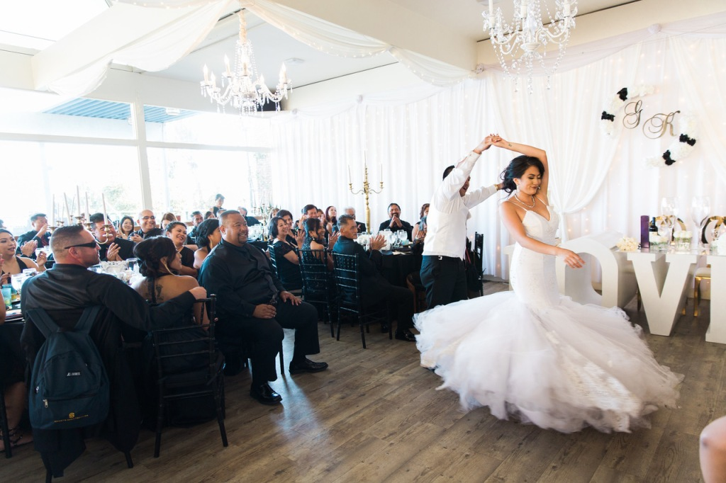 "Bride Kimberly twirls in her Lauren Elaine ""Arabelle"" mermaid wedding dress."