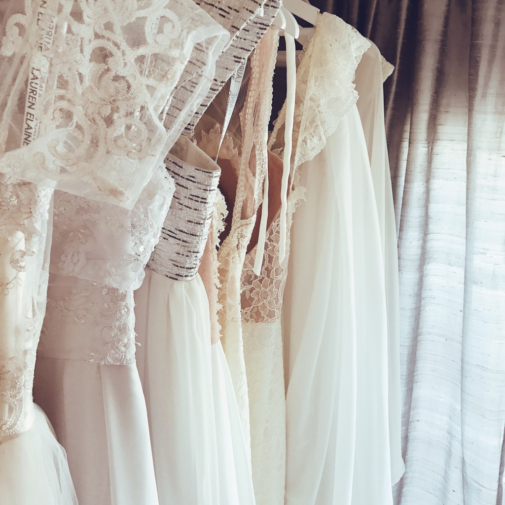 Wedding dresses and bridal gowns hanging on racks inside the Lauren Elaine Style House salon in Los Angeles.