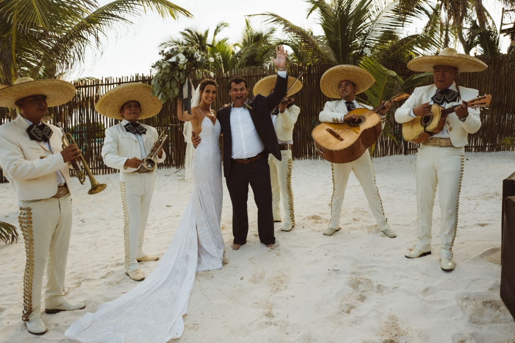 "Bride Geniffer celebrates in Mexico with a Mariachi band and her custom Lauren Elaine ""Prism"" wedding dress."