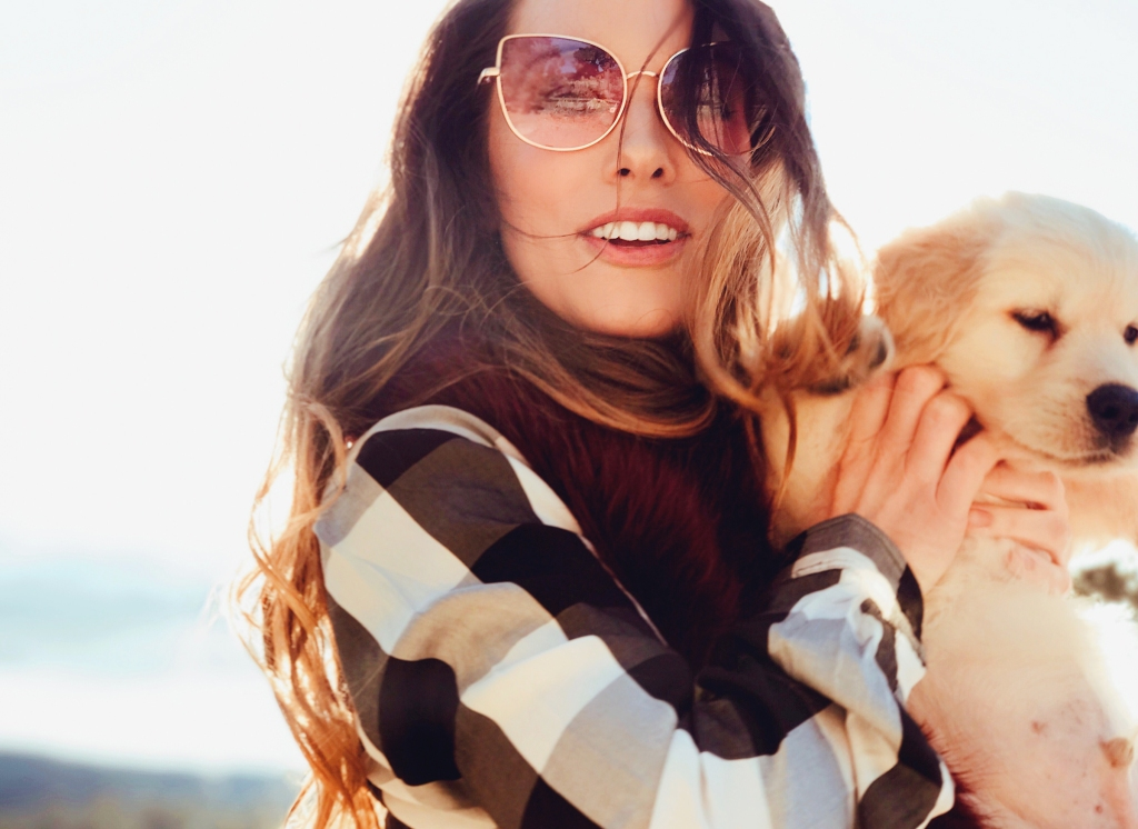 "Fashion Designer Lauren Elaine plays with her golden retriever puppy, ""Mojave"""