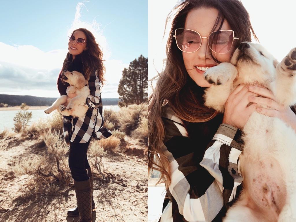 """Fashion Designer Lauren Elaine plays with 8 week old golden retriever puppy, """"Mojave."""""""