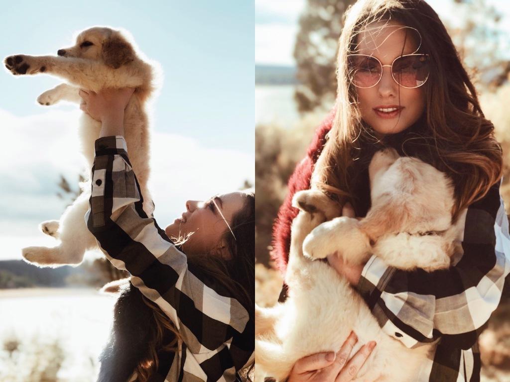 "Bridal Designer Lauren Elaine holds her 8 week old Golden Retriever puppy ""Mojave."""