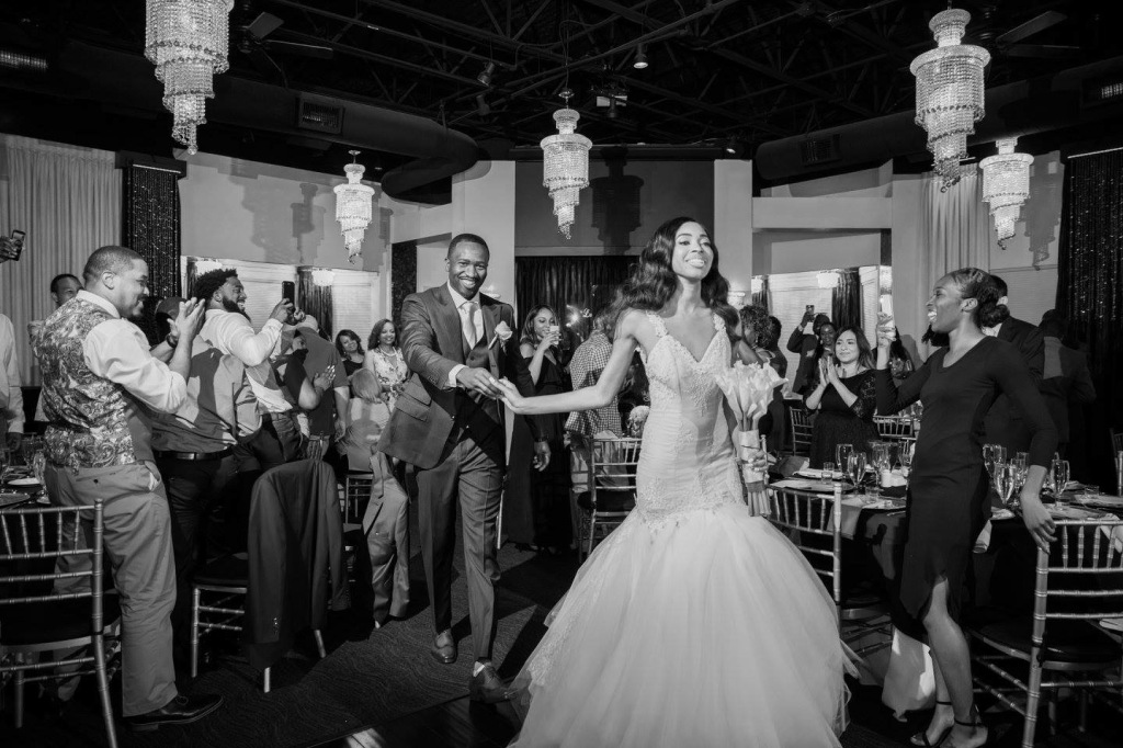 Dallas, TX bride Lakiska celebrates as she enters her wedding reception.