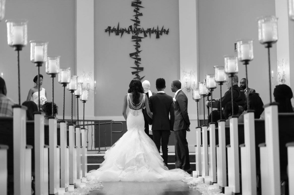 "Bride Lakiska ties the knot in a custom Lauren Elaine ""Arabelle"" mermaid wedding dress with detachable pearl strand."