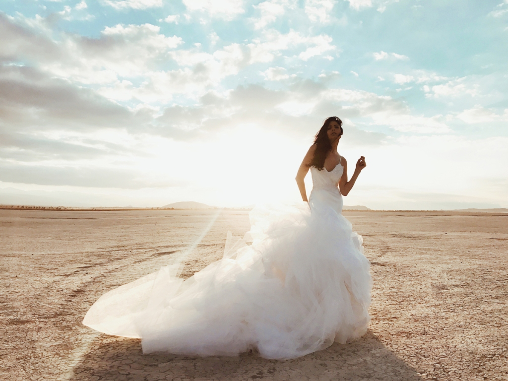 A model wears the Elysian gown by Lauren Elaine Bridal at El Mirage dry lake bed in California