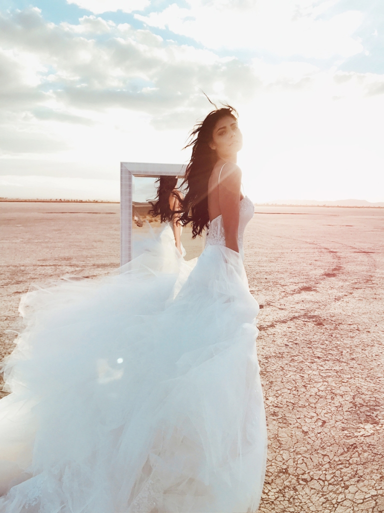 Lauren Elaine Elysian mermaid wedding dress editorial image with mirror in the desert at el mirage dry lake bed