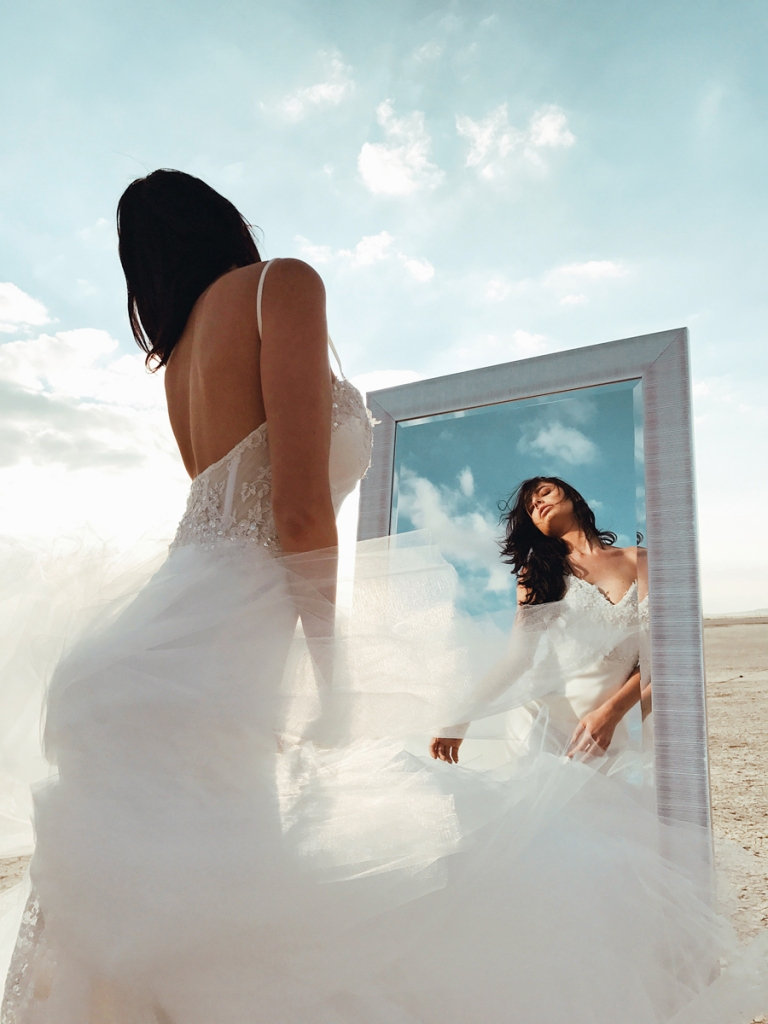 Lauren Elaine Elysian mermaid wedding dress editorial image with mirror in the desert at el mirage dry lake bed in california