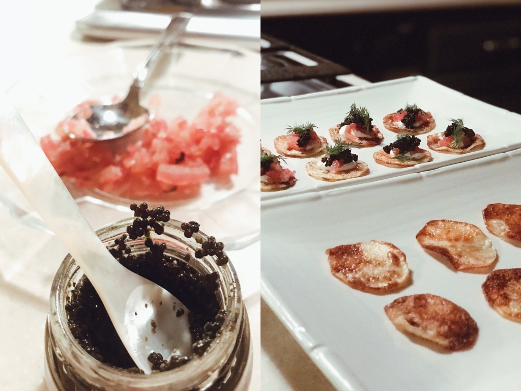 Caviar served on homemade potato crips with pickled red onions and horseradish