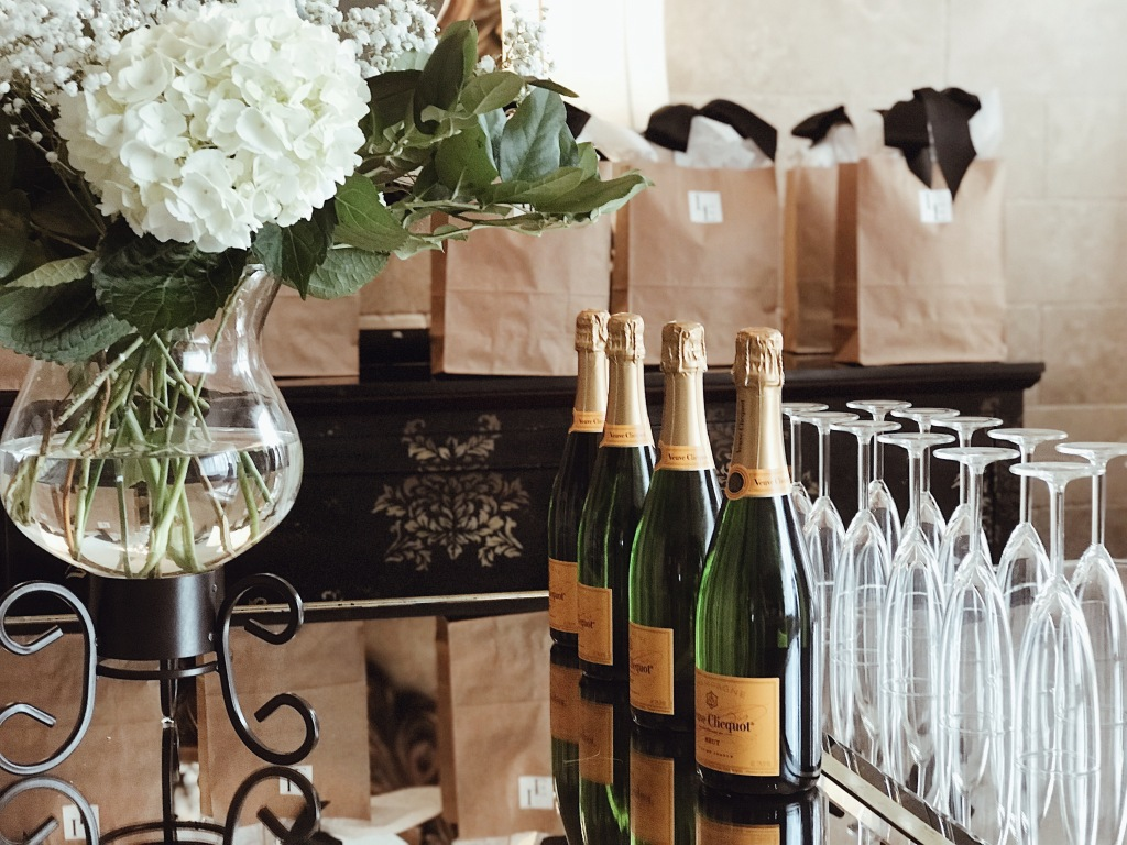 Brides enjoy Veuve Cliquot champagne and deluxe bridal giftbags at the Lauren Elaine Bridal Trunk Show in Houston, Texas