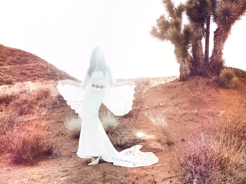 Bohemian angel wing cape sleeve wedding dress by Lauren Elaine Bridal