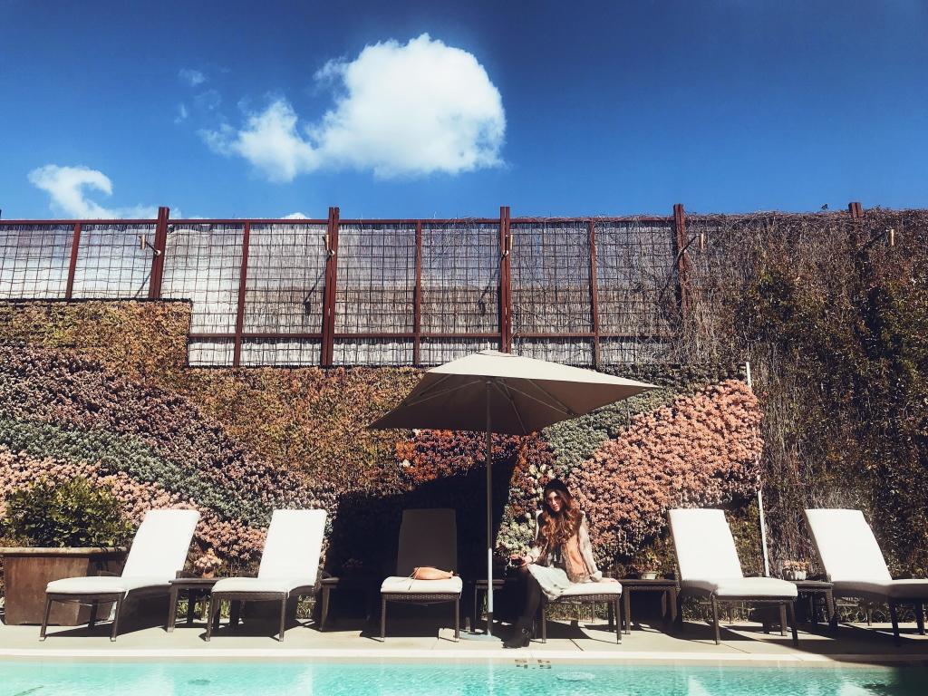 Blogger Lauren Elaine lounges poolside at the Fess Parker Wine Country Inn