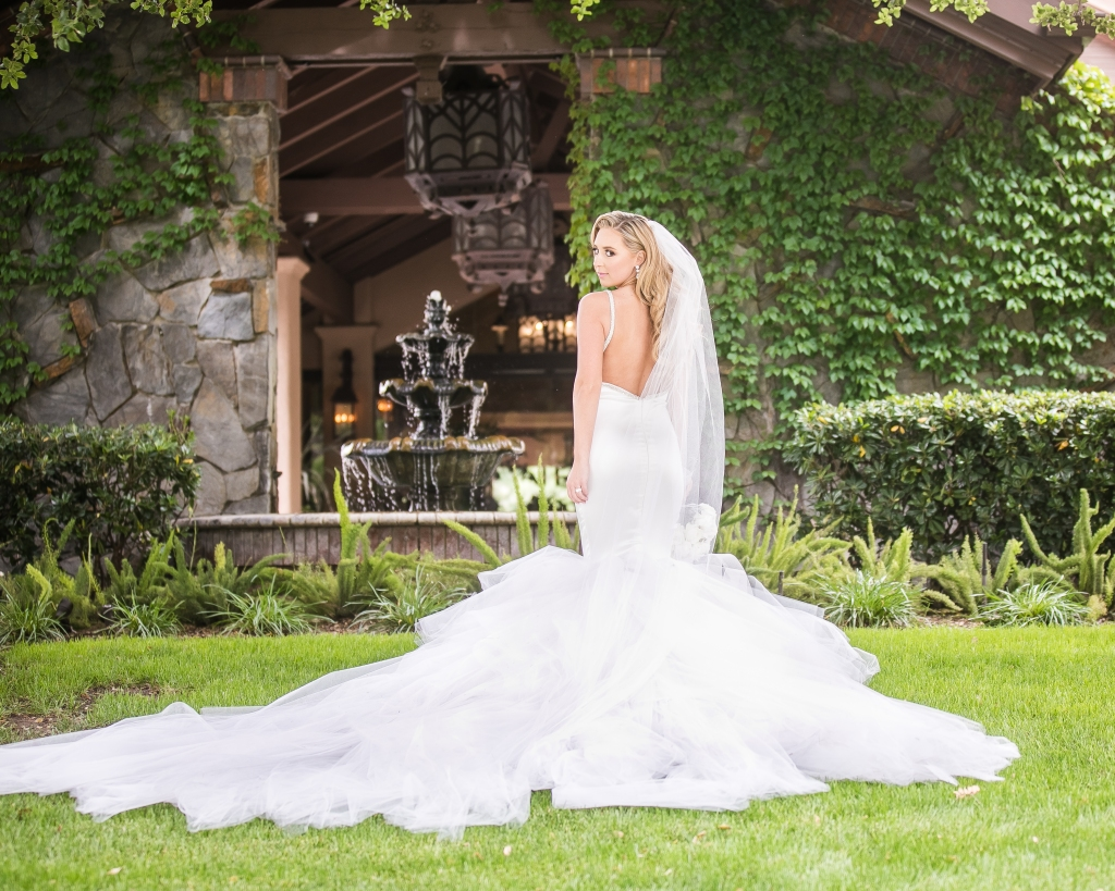 Bride Amanda wears a custom Lauren Elaine Epiphany gown with detachable cathedral train