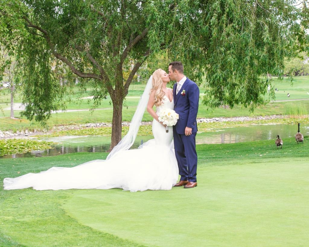 """Bride Amanda celebrates her wedding in a custom Lauren Elaine """"Epiphany"""" gown"""