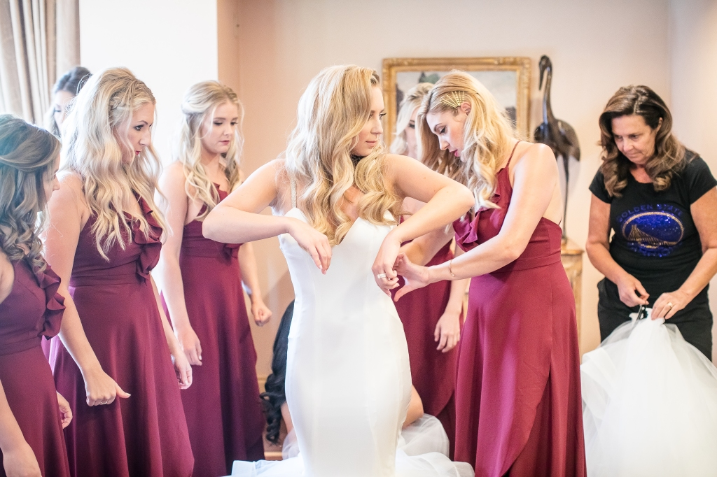 "Bride Amanda gets dressed in her custom Lauren Elaine ""Epiphany"" wedding dress"