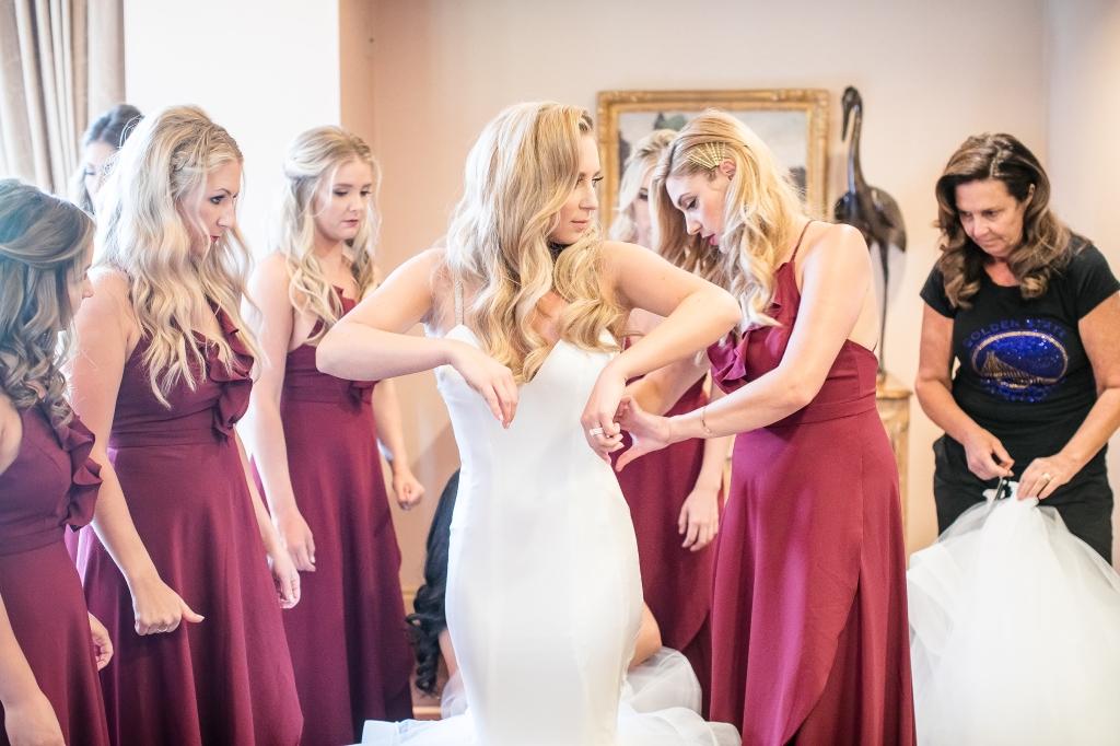 "Bride Amanda gets dressed in her custom Lauren Elaine ""Epiphany"" wedding dress"
