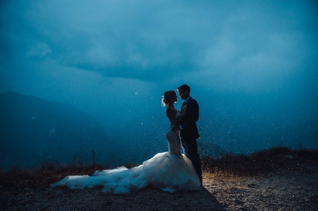 "A bride at Lake Bled, Slovenia in a custom Lauren Elaine mermaid ""Epiphany"" wedding dress"